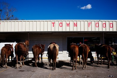 Horses are hitched in front of a convenience store during Mardi Gras celebrations in Mamou, Louisiana on Tuesday, February 16, 2010.
