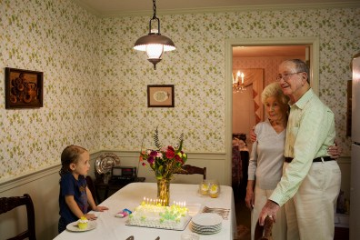 Madelyn Eich, 4, looks on as her great-grandfather Eugene Martin embraces his girlfriend, Anne Stultz, prior to his 89th birthday at his home in Winston-Salem, North Carolina, on September 24, 2011.