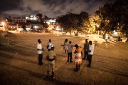 Every few days a group of young people from Cape Coast gathers together at the town square at night time to pray and discuss verses from the Bible.