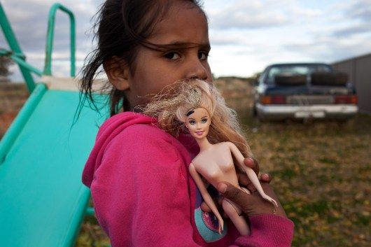 Rhianna Harris (age 5) with her barbie. The reality for Rhianna is that the future likely looks very different than it does for her non-Aboriginal counterparts. David Maurice Smith/Oculi.