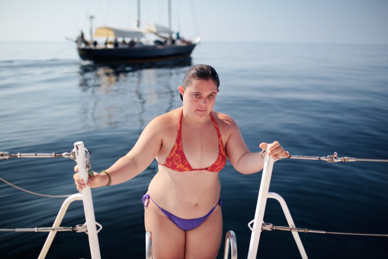 Benedetta on an extremely hot morning in Stromboli island. Since 2006, Rome's branch of the Italian Association of People with Down syndrome is running a sailing program for young adults. Rather than being a sailing school, the program uses the boat environment to challenge the adaptive skills of its participants. In 2012 a group of the eight most proficient users were selected to join up with the official team of Mascalzone Latino to participate, on board of La Poste as a mixed crew, for the historical Barcolana sailing race. La Poste scored and amazing 24th position among more than 1000 participants.