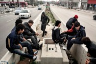 2012. Patras. Greece. A group of adolescents waiting to attempt to illegally board trucks going to Italy. Patras is one of the main escape points from Greece, due to the numerous cargo ships which dock in the port and which are then sent to Italy. It is therefore one of the points where it is possible to attempt to escape from Greece.