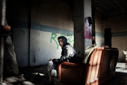 2011. Athens. Greece. 17-year old Ali from Algeria lives in the old Columbia records factory. Columbia was once a leader in the music industry but today the factory has been completely abandoned and kids of various nationalities now take refuge there.