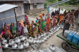 People gather to collect drinking water from Reverse Osmosis Plant of an NGO's Project in Shyamnagar, Satkhira. Bangladesh is one of the countries most vulnerable to the effects of climate change. The regular and severe natural hazards that Bangladesh already suffers from – tropical cyclones, river erosion, flood, landslides and drought – are all set to increase in intensity and frequency as a result of climate change. Sea level rise will increasingly inundate coastal land in Bangladesh and dramatic coastal and river erosion will destroy lands and homes. These and the many other adverse effects of climate change will severely impact the economy and development of the country.One of the most dramatic impacts will be the forced movement of people throughout Bangladesh as a result of losing their homes, lands, property and livelihoods to the effects of climate change. While it is impossible to predict completely accurate figures of how many people will be displaced by climate change, the best current estimates state that sea level rise alone will displace 18 million Bangladeshis within the next 40 years. The vast majority of these people will be displaced within Bangladesh – not across international borders – presenting the Government with enormous challenges, particularly when it comes to finding places to live and work for those displaced.