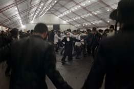 Pilgrims dance throughout the night at a private party on the final night of the pilgrimage. Approximately 30,000 religious Jews make an annual pilgrimage to the tomb of Breslover Rabbi Nachman's tomb in Uman, Ukraine for Rosh Hashanah. The pilgrimage is unique because it attracts men from across the spectrum of Judaism. In making the pilgrimage, they believe that Rabbi Nachman will intercede on their behalf on Yom Kippur, the Jewish day of atonement.