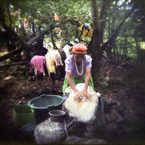 A woman washes clothes on a rock, in the department of Jalapa, Guatemala. During the civil war, vigilante groups headed by Ladino landowners burned homes and arrested and killed landless, poor indigenous Mayans. They justified these killings by saying there was guerrilla activity and the indigenous were providing guerrilla support.