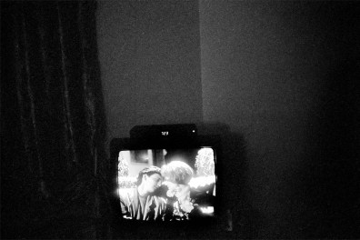 On a TV screen, two people look at each other. Apartment of Dale Layne. March 8, 2012