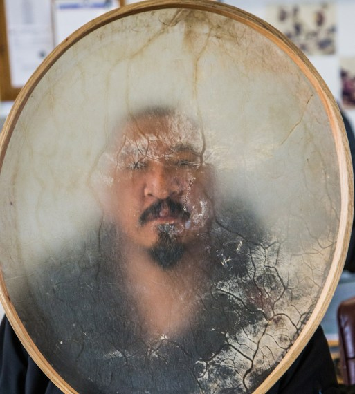 A southwest wind has closed the lead. Othniel Anaqulutuq Omittuk Jr peers through the bowhead liver membrane skin of his drum, then joins other whalers to drum, sing and dance. The wind shifts. The lead opens. Tikigaq.