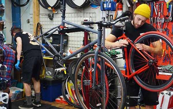 A bike technician inside Edgeworks. Photo by Burl Rolett.
