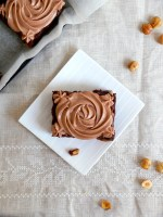 I'm getting Older or My Gooey Banana Nutella  Brownies packed with Toasted Hazelnuts and topped with Luscious Mascarpone  Nutella Frosting/ J'ai encore vieilli ou Mes Brownies Nutella Banane aux noisettes torréfiées et glaçage Nutella Mascarpone.