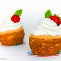 angel food cupcakes with whipped cream topping