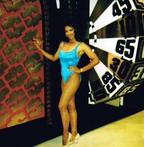 Kathleen Bradley poses next to the big wheel (CBS)