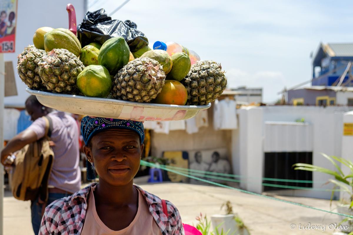 woman selling fruit om her head