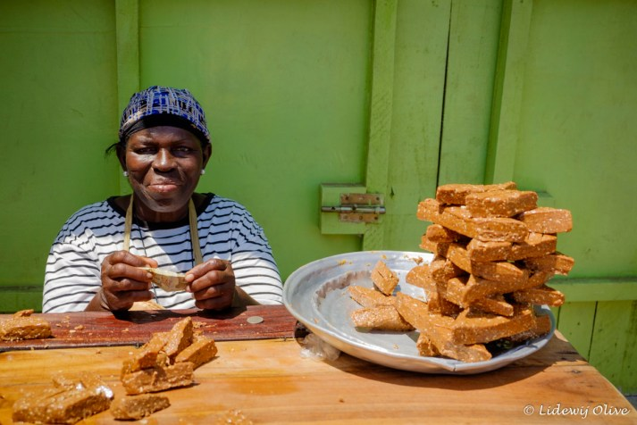 woman selling cookies in Accra, Ghana