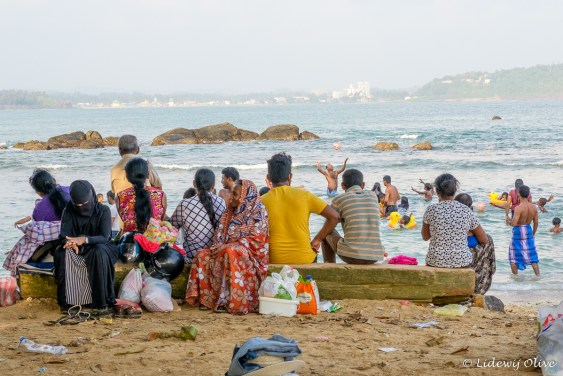 At Galle beach: detail: woman at the left is fully covered