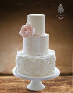 blush pink rose and ruffles wedding cake