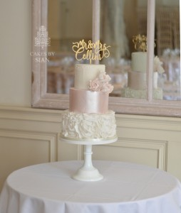 Pink shimmer and ruffles wedding cake