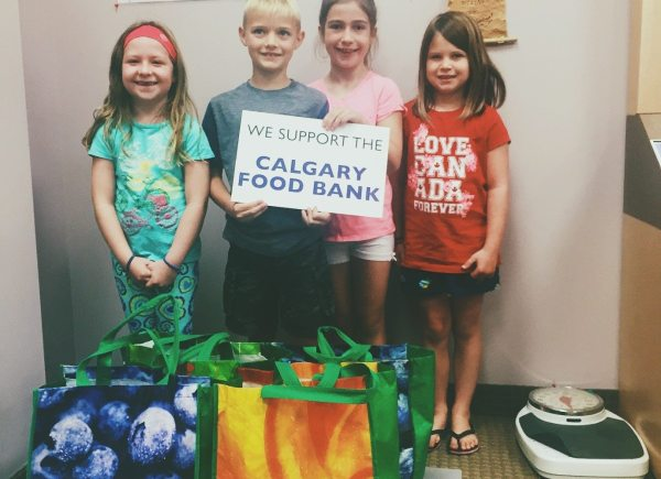 These youngins threw a food drive in their neighourhood and raised 56 pounds of food all on their own!