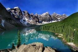 © Moraine Lake  - This classic mountain scene is the setting for Moraine Lake Lodge which is open from June - early Oct.