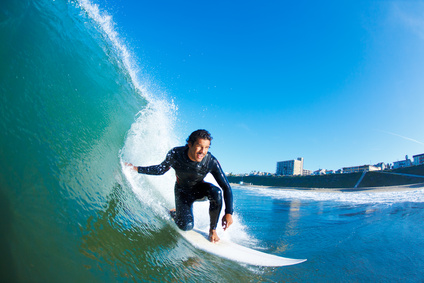 For shots such as this, the photographer probably has to be able to at least swim and ride a board out from shore. In general, sports photography is a physical endeavor and requires above average fitness levels from photographers.