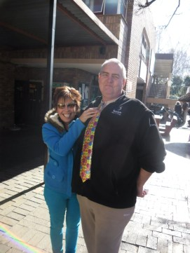 CANSA Volunteer Franz Heidler and the lady golfer from Kempton Park who bought a crazy tie for her son's matric farewell
