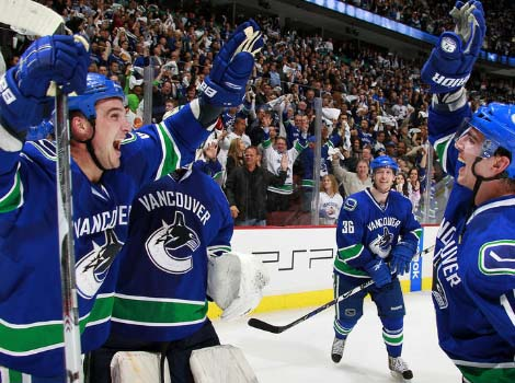 Alex Burrows and Shane O'Brien high-five