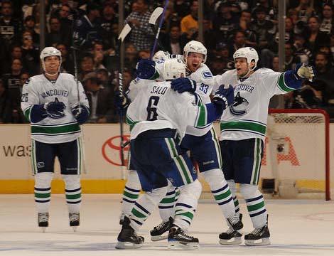 Henrik Sedin and Canucks celebrate game 4 game-winning goal.