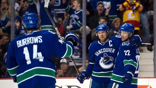Henrik Sedin, Daniel Sedin and Alex Burrows, Vancouver Canucks