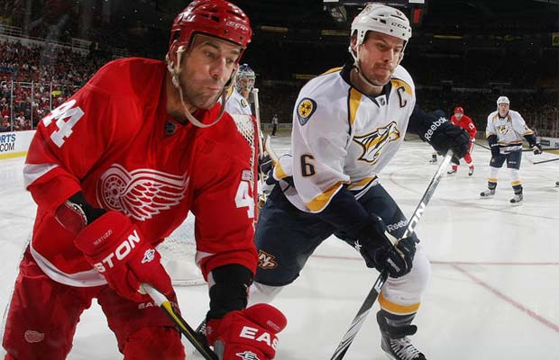 Todd Bertuzzi of the Detroit Red Wings and Shea Weber of Nashville Predators do battle