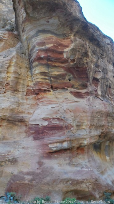 Multi colored stone walls of the canyon leading into Petra