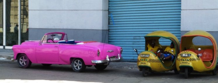 Classic cars and coco taxis