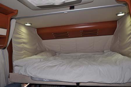 Luxury double bed inside the Hymer B544 motorhome