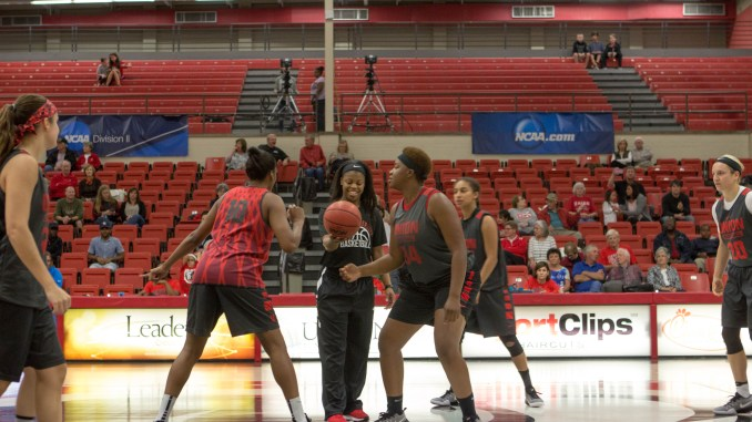 The Lady Bulldogs get ready for the tip off at Bulldog Madness.   Photo by Morgan Morfe, Staff Photographer