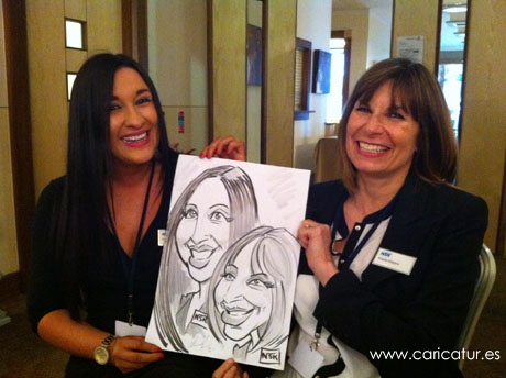 Delegates at the Irish Dental Association enjoying live caricature entertainment by Allan Cavanagh, of Caricatures Ireland, in the Radisson Blu Galway