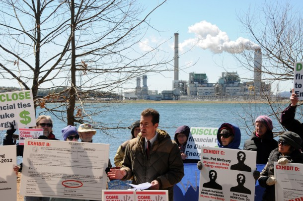Gerrick Brenner, with Progress NC Action, lead a press conference Thursday in Asheville calling on Gov. Pat McCrory to 'come clean' about ties to Duke Energy. Angie Newsome/Carolina Public Press
