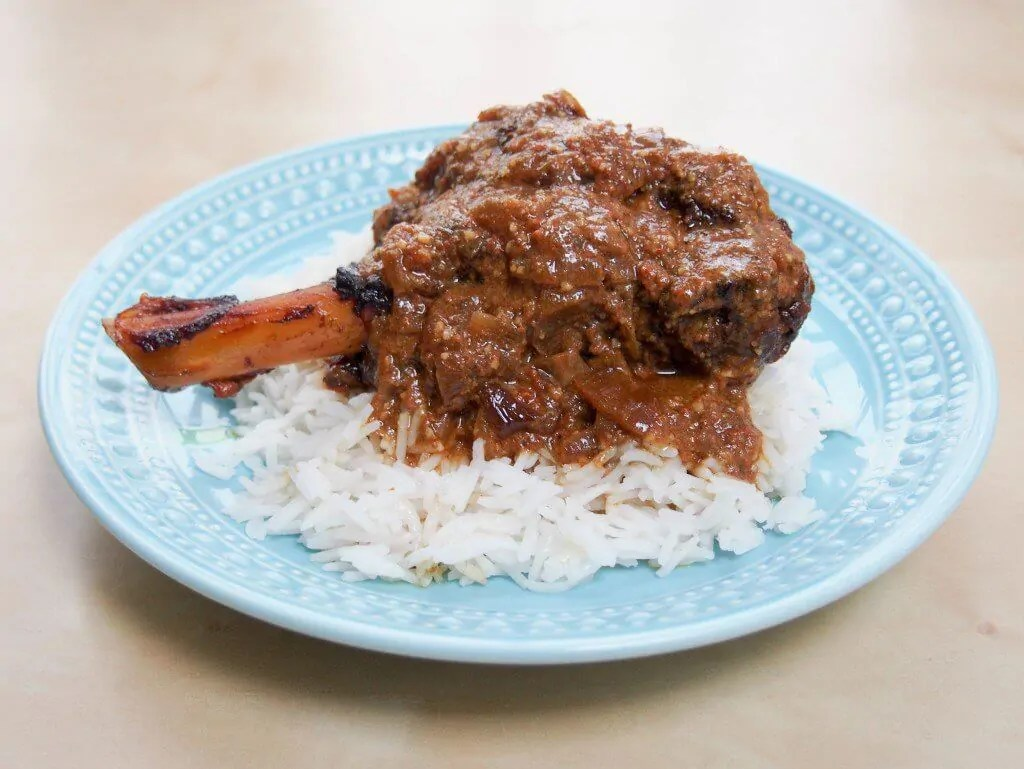 This delicious lamb rogan josh is made with lamb shanks in the slow cooker. Easy, meltingly tender and incredibly delicious: so full of aromatic Indian flavors.