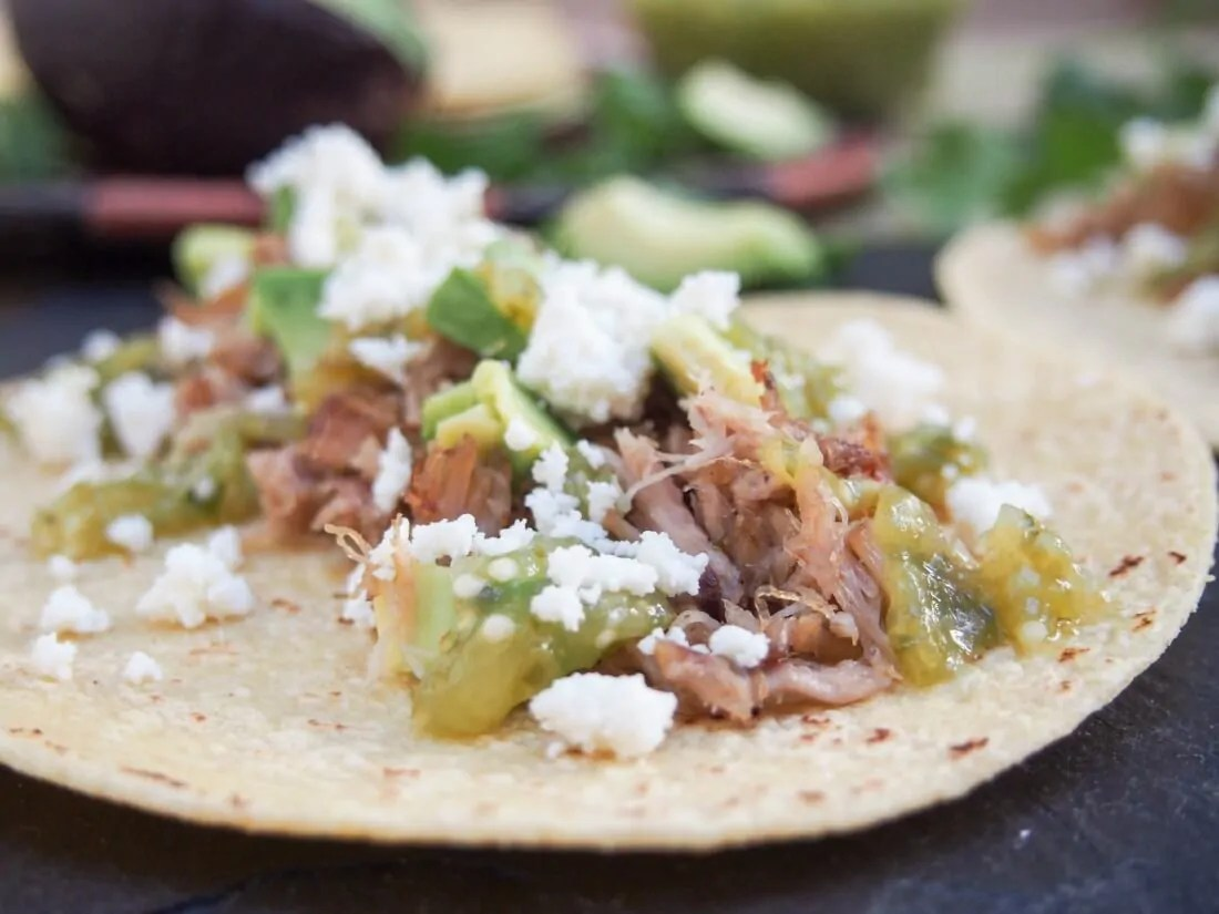 Pork carnitas tacos with tomatillo salsa verde