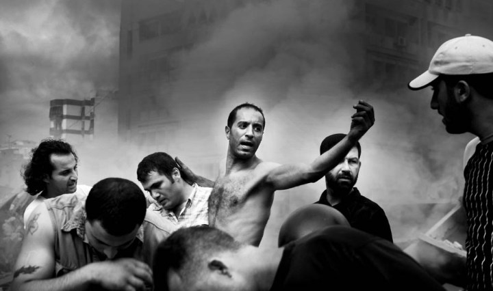 Moments after an Israeli air strike destroyed several buildings in Dahia. Beirut. August 2006