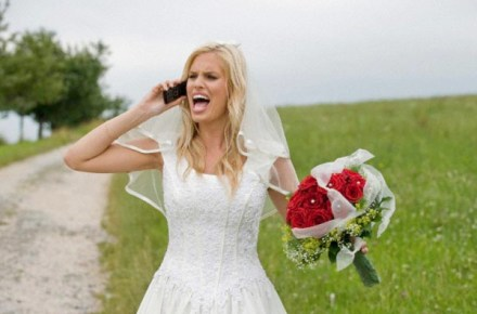 Bride shouting on the phone, holding bouquet --- Image by © Michael Diehl/Westend61/Corbis