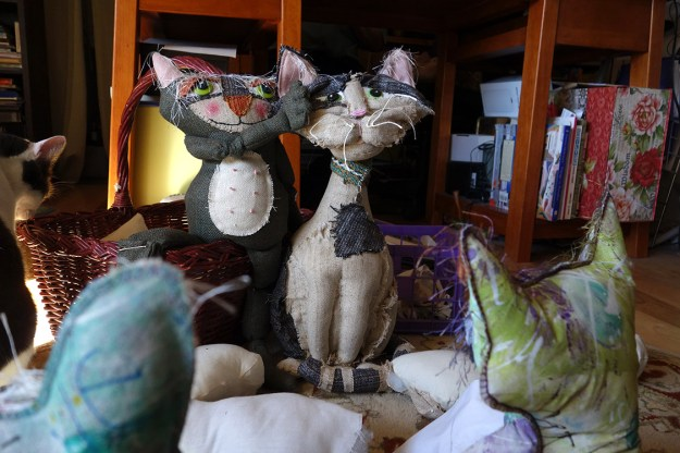 A beautiful, tall soft sculptured cat doll made out of an old suit.