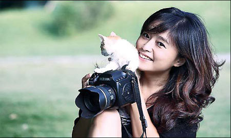 Lovely Taiwanese woman with her camera and a kitten.