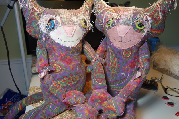 Ginger poses with her cousin, a new cat doll, made out of the same 60's vintage fabric as Ginger.