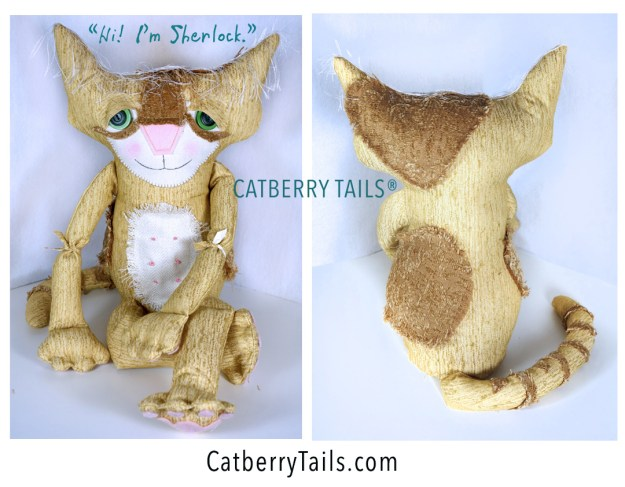 Adorable soft sculptured cat named Sherlock. He is gold color with soft butterscotch color patches. His tail is striped.