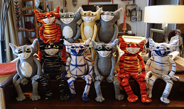 A fun assortment of soft sculptured cat dolls posing for the camera.