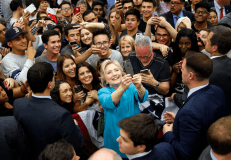 Democratic presidential candidate Hillary Clinton takes selfies with supporters after a rally at a rally at the University of California, Riverside, Tuesday, May 24, 2016, in Riverside, Calif. (AP Photo/John Locher)