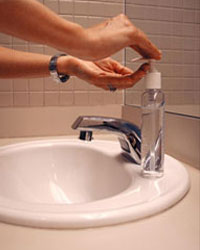 Photo: Using hand sanitizer