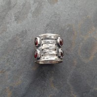 Sterling Silver ring with 4 garnets and cut-outs on 15 mm wide