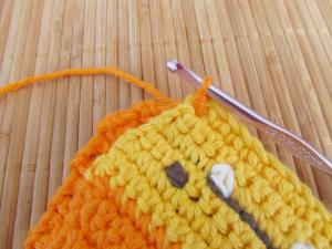 "Attach yarn through first ""ravine"" of both pieces"