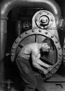 Lewis_Hine_Power_house_mechanic_working_on_steam_pump