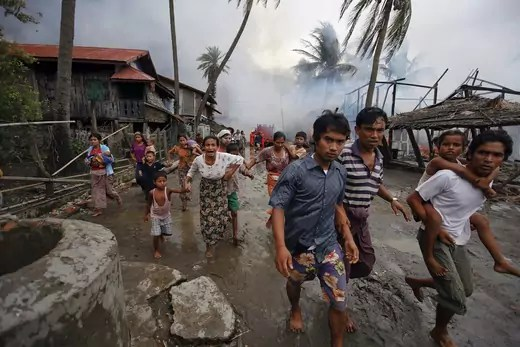 Rohingya run from a fire set in Sittwe, June 10, 2012.